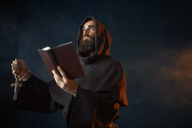 Medieval monk with spellbook calling the spirits