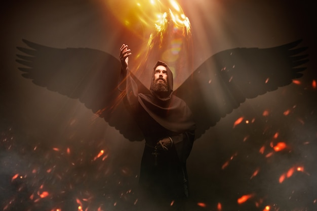 Средневековый монах с крыльями, религия. таинственный монах, летящий в темном плаще, тайна и духовность