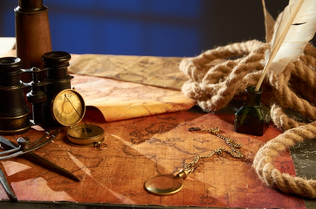 Medieval objects for navigation in the form of maps magnifying glass and compass