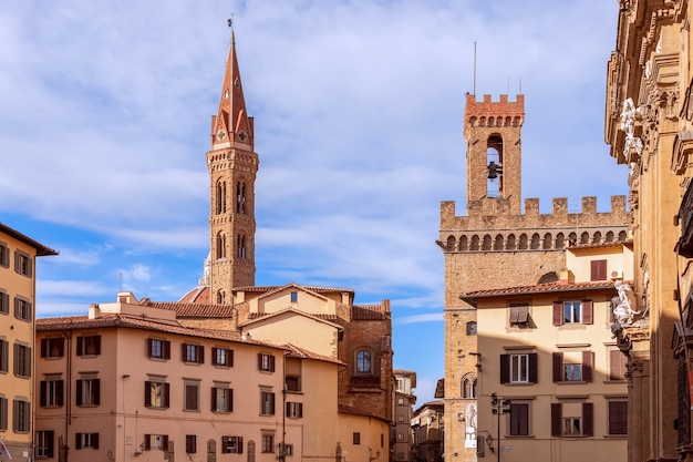 Medieval square (piazza di san firenze) with bell towers in the historical centre of florence, italy