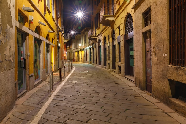 Medieval street at night in milan, lombardia, italy