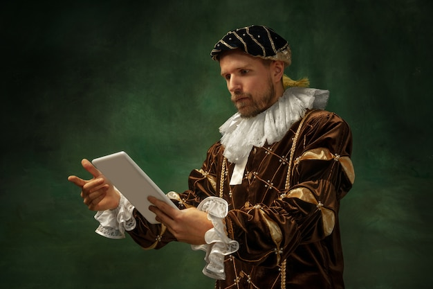 Medieval young man in old-fashioned costume