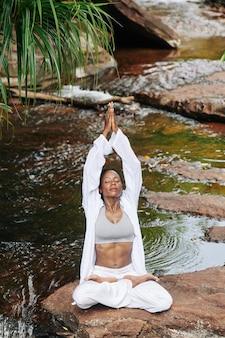 Meditating calm young woman