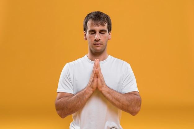 Meditating man medium shot