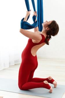 Meditation during pregnancy, exercises for pregnant women on air hammocks.