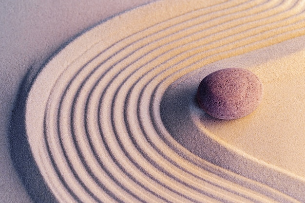 Meditation zen garden with stones on sand, toned picture