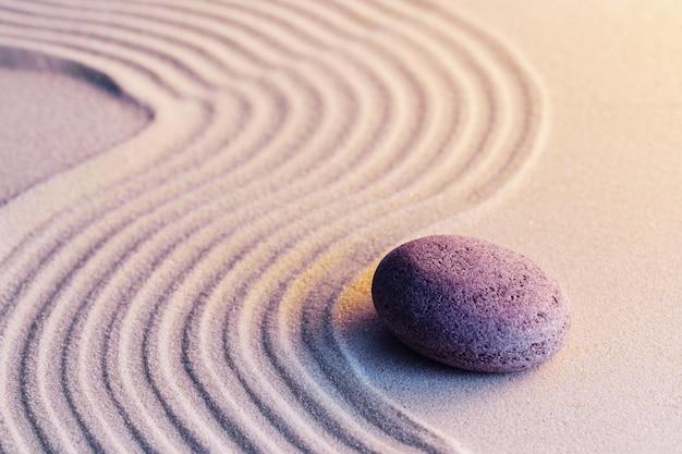 Meditation zen garden with stones on sand, toned