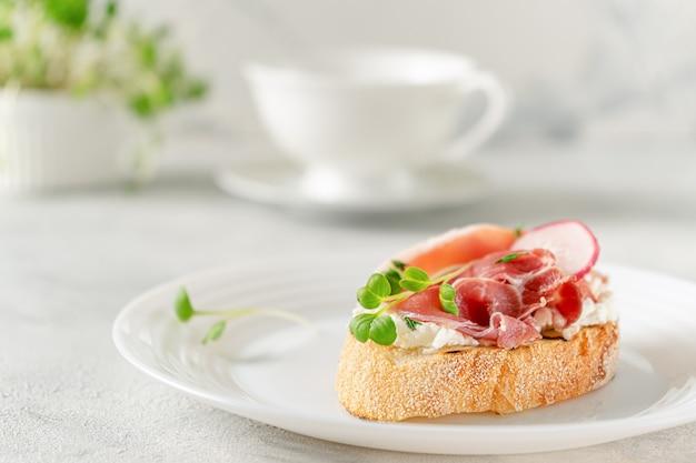 Mediterranean appetizer. open sandwich with prosciutto or jamon