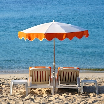 Mediterranean beach chairs sun umbrella square format