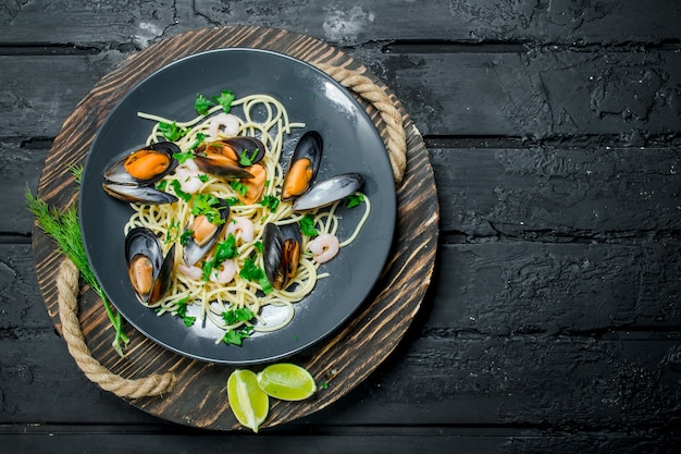Mediterranean food. seafood spaghetti with clams on a rustic table.