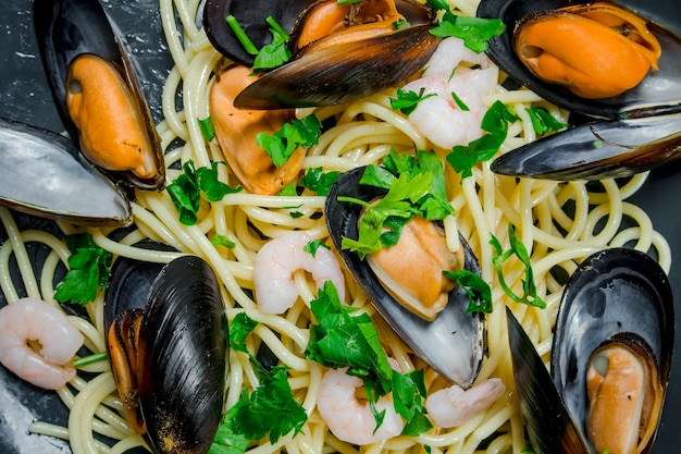 Mediterranean food. seafood spaghetti with clams. top view