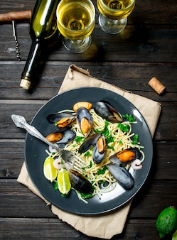 Mediterranean food. seafood spaghetti with clams and white wine.