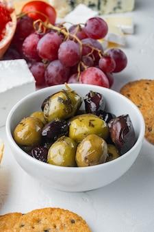 Mediterranean fresh olives, on white table
