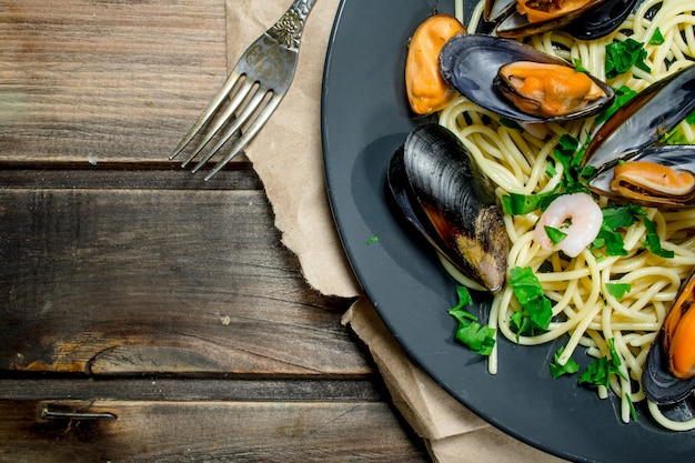 Mediterranean pasta. seafood spaghetti with clams and lime. on a wooden.