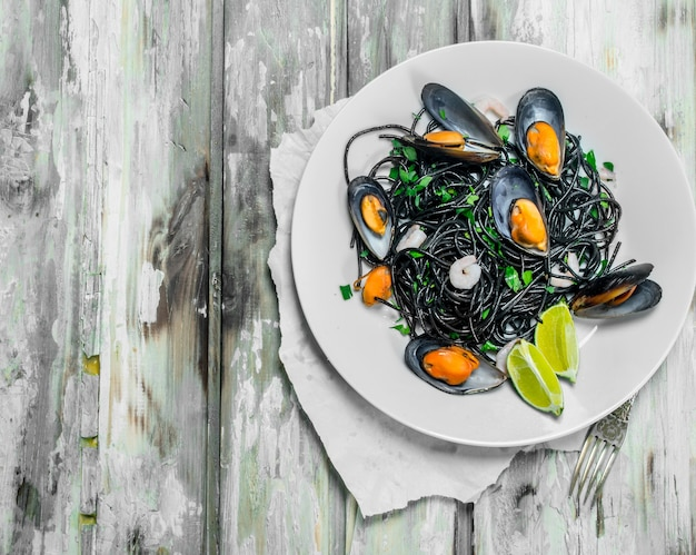 Mediterranean pasta. spaghetti with cuttlefish ink and clams.
