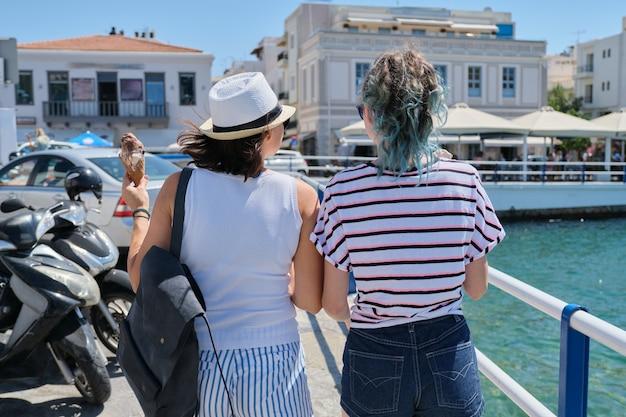 Mediterranean, people women backs near sea promenade