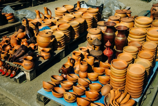 Mediterranean rustic large clay wine pitchers.