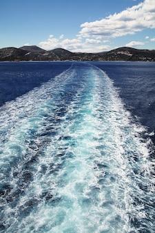Mediterranean sea  .clear dark blue water.trail of ferry.
