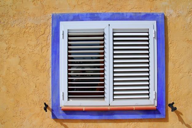 Mediterranean wood window blue frame