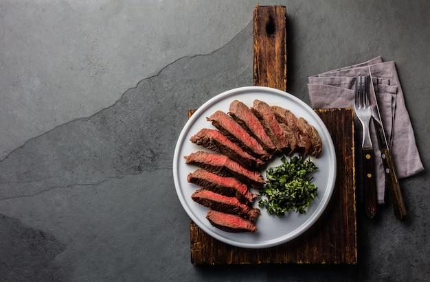 Medium beef steak on white plate