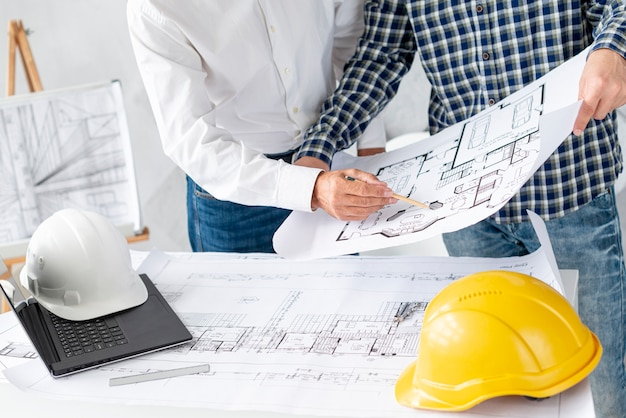 Medium shot architect discussing project with client