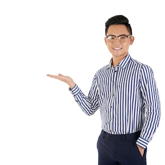 Medium shot of asian man gesturing as if presenting a product