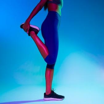 Medium shot of athlete stretching