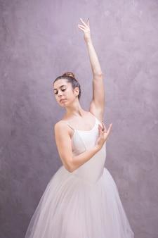 Medium shot ballerina looking away