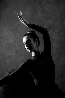 Medium shot ballerina posture greyscale