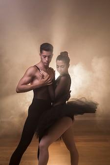 Medium shot ballet choreography