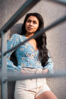 Medium shot of beautiful woman looking away