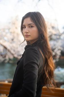 Medium shot beautiful woman outdoors