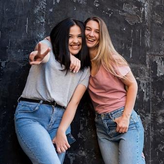 Medium shot best friends posing on a dark background
