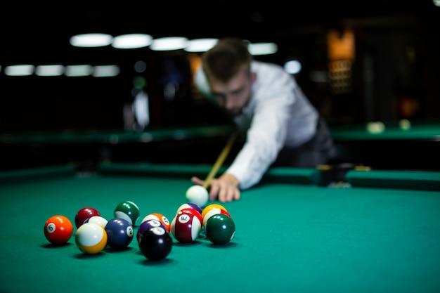 Medium shot blurred man playing billiard