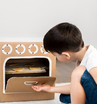 Medium shot boy cooking at home