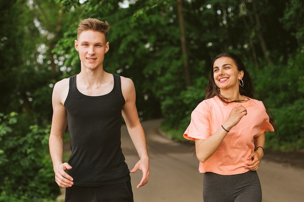 Medium shot boy and girl running together