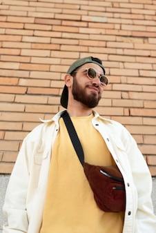 Medium shot boy posing with sunglasses
