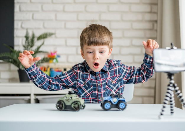 Medium shot boy with cars