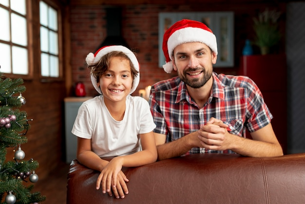 Medium shot boy with father posing together