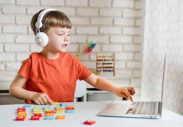 Medium shot boy with laptop