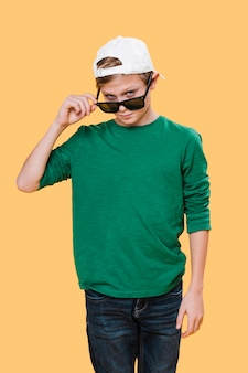 Medium shot of boy with sunglasses
