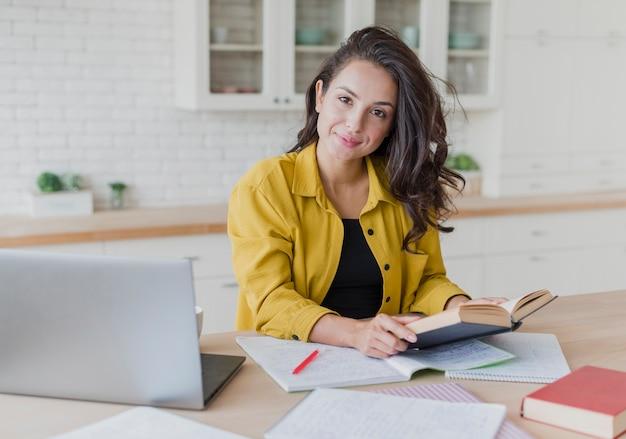 Medium shot brunette woman studying