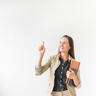 Medium shot business woman pointing with copy space