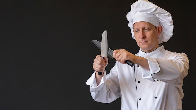 Medium shot chef sharpening knives