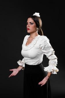 Medium shot confident flamenca dancer