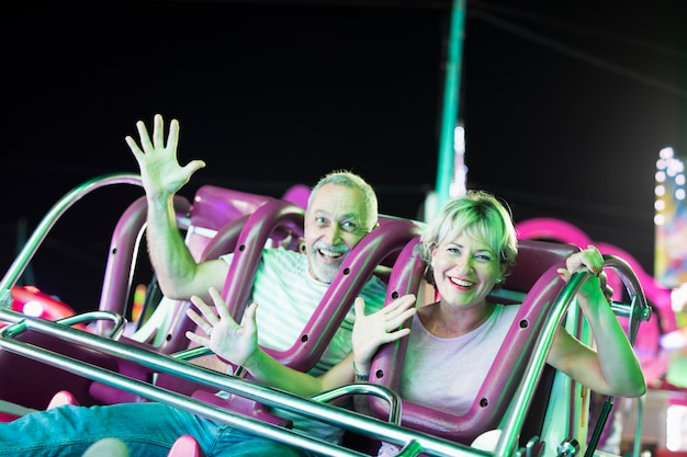 Medium shot couple in amusement ride