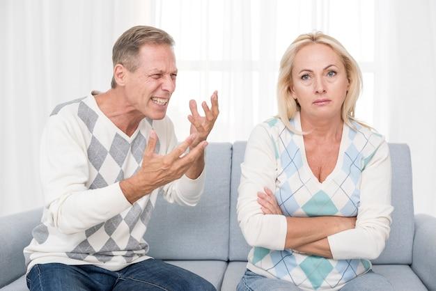Medium shot couple arguing indoors