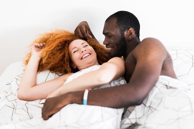 Medium shot of couple in bed