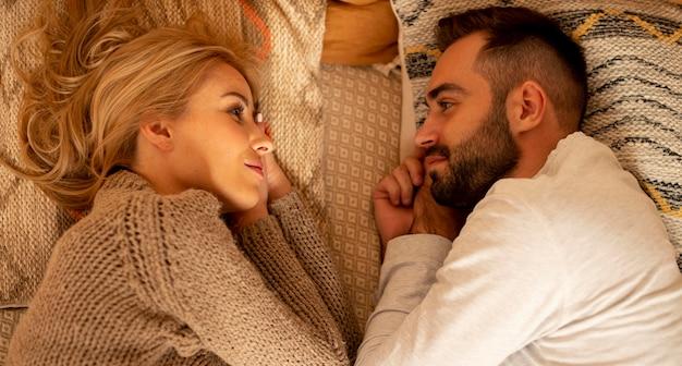 Medium shot couple in bed