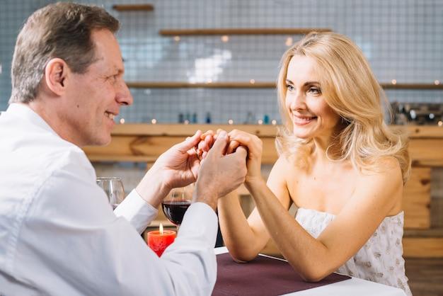 Medium shot of couple holding hands